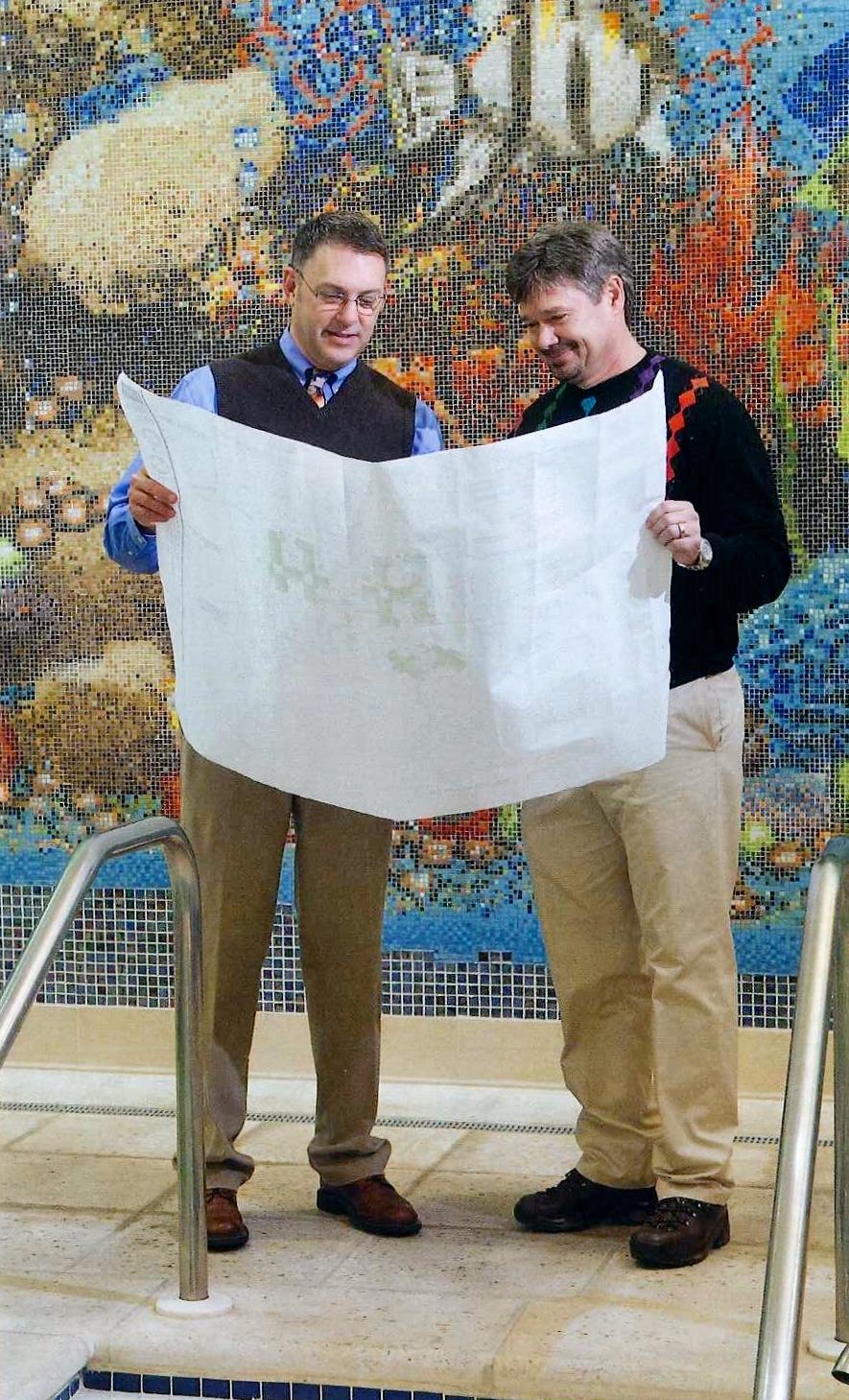 Cambridge/Davis architects look over plans