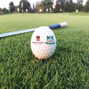 Close-up shot of golf ball with McKinley Building branding/logo